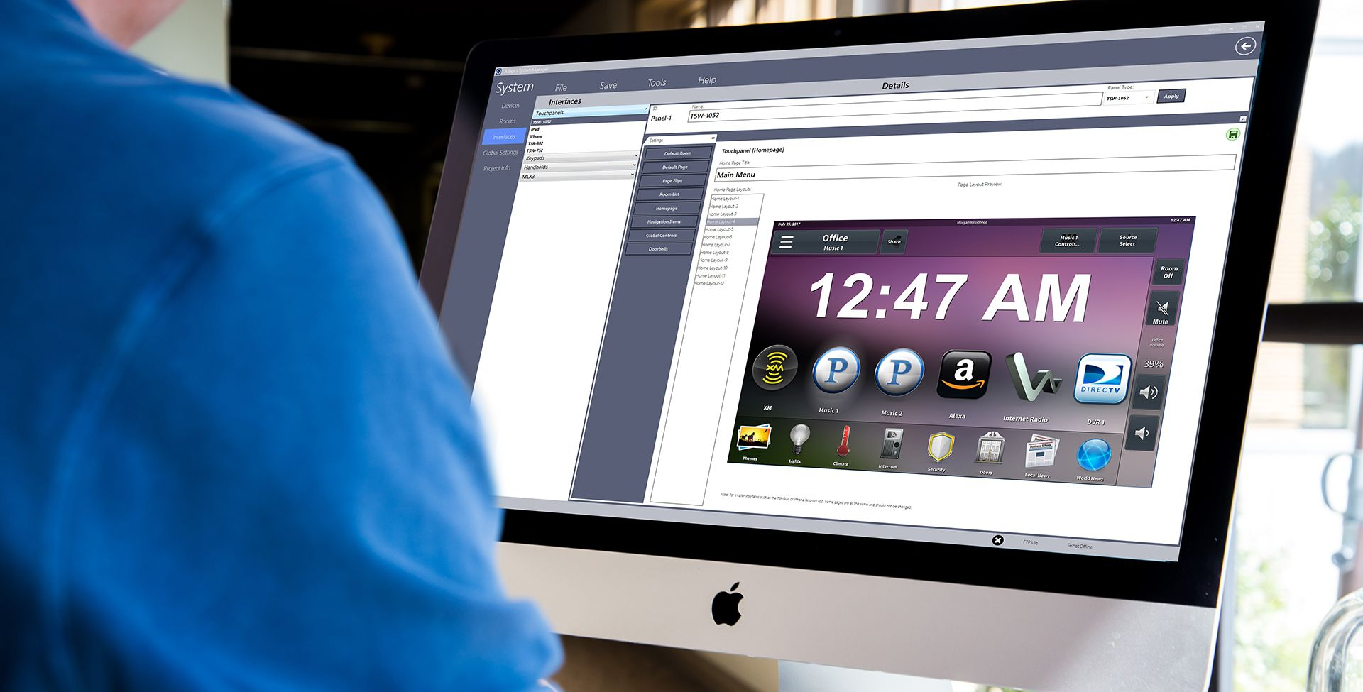 Man using Adapt System Manager application on iMac