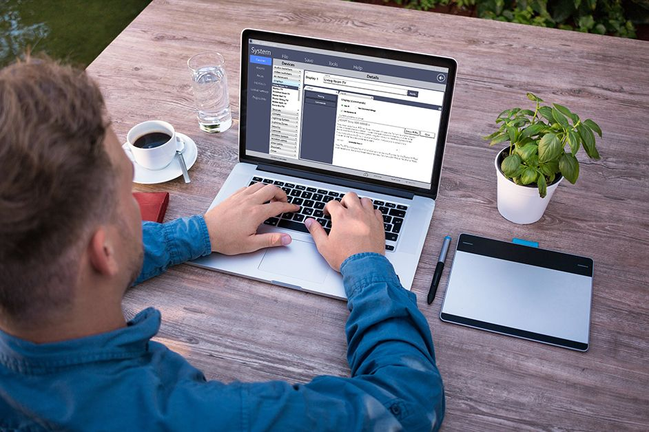Man using Adapt System Manager application on laptop
