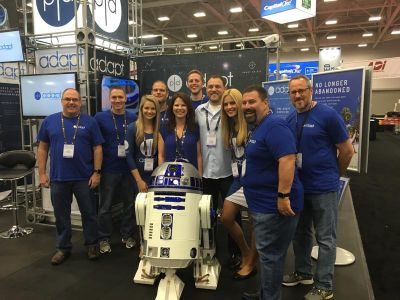 PanTech Design Adapt booth at CEDIA 2016, group photo with R2D2